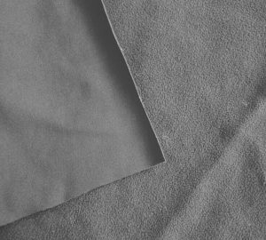 Polyester four way stretch fabric bonded with polar fleece